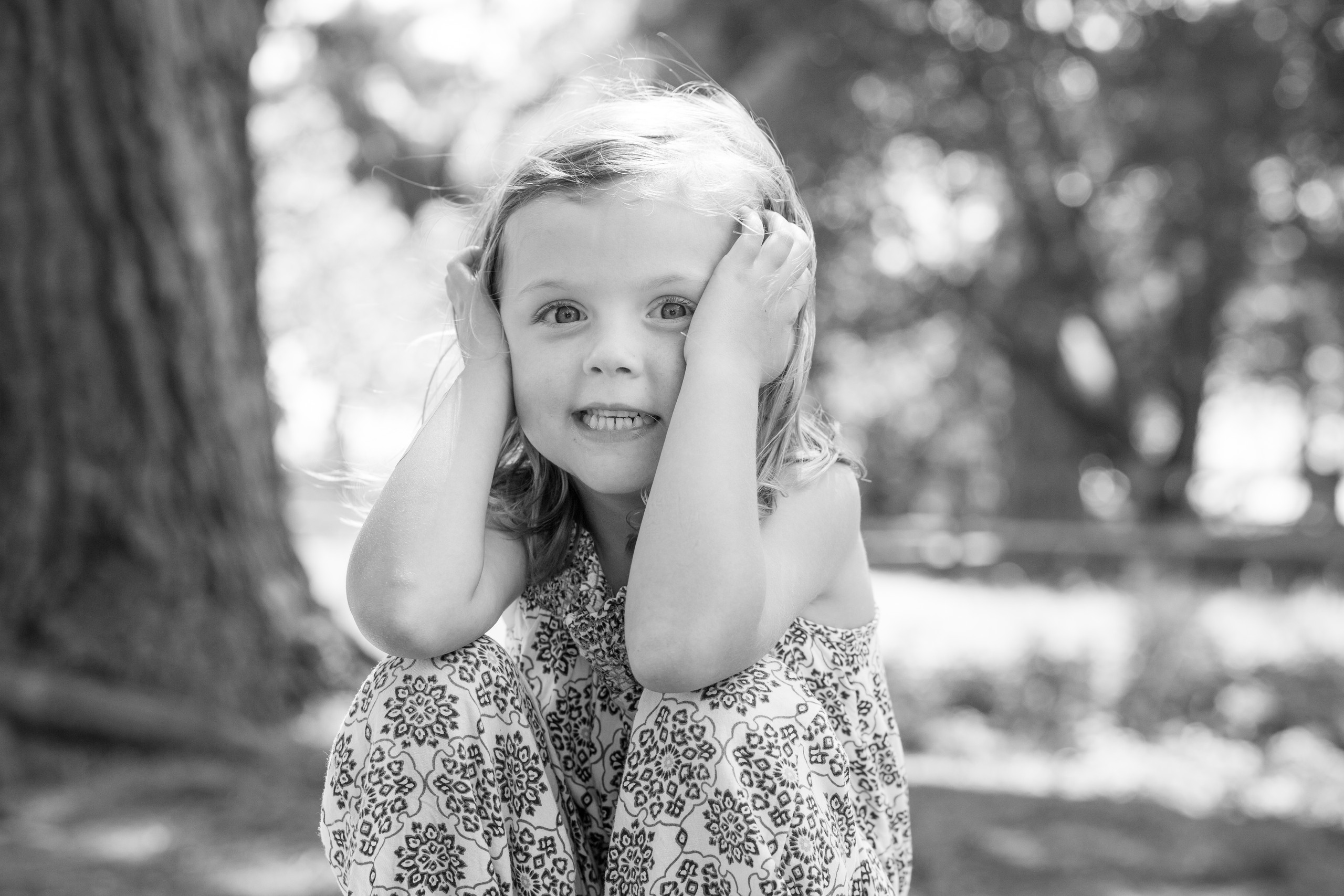 small child poses for the photographer