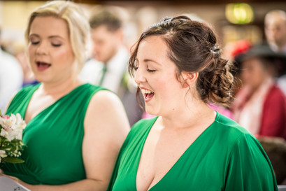 bridesmaids sing in traditional church wedding at swansea and gower location