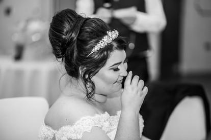 Bride listening to Speech at Stradey Park Hotel Llanelli, Carmarthenshire Wedding Photography