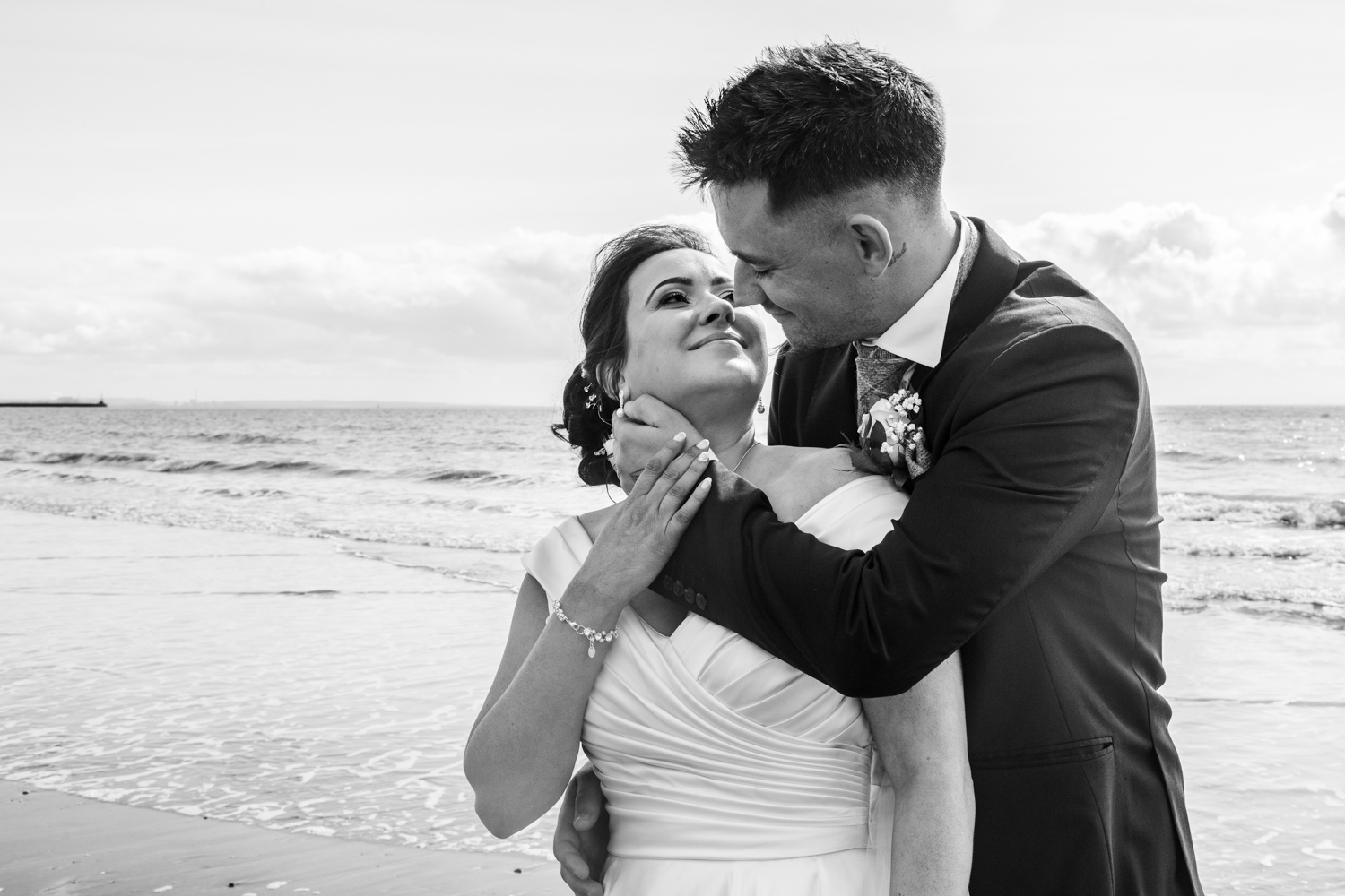 elegant and natural photograph of bride and groom on swansea bay