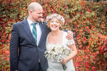 autumn colours surround bride and groom as they pose in swansea for wedding photographer