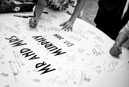 wedding banner by swansea bay for guests to sign
