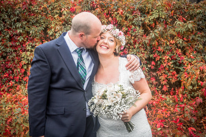 groom places a kiss on new bride in swansea and carmarthenshire