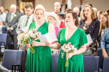 singing bridesmaids in green dresses from swansea bridal
