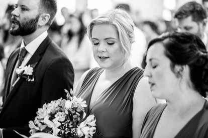 a natural look from a bridesmaid in a black and white photograph