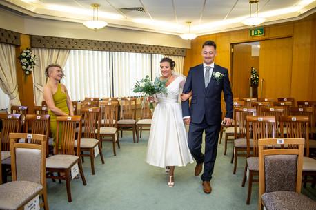 bride and bridegroom enter registry office in swansea