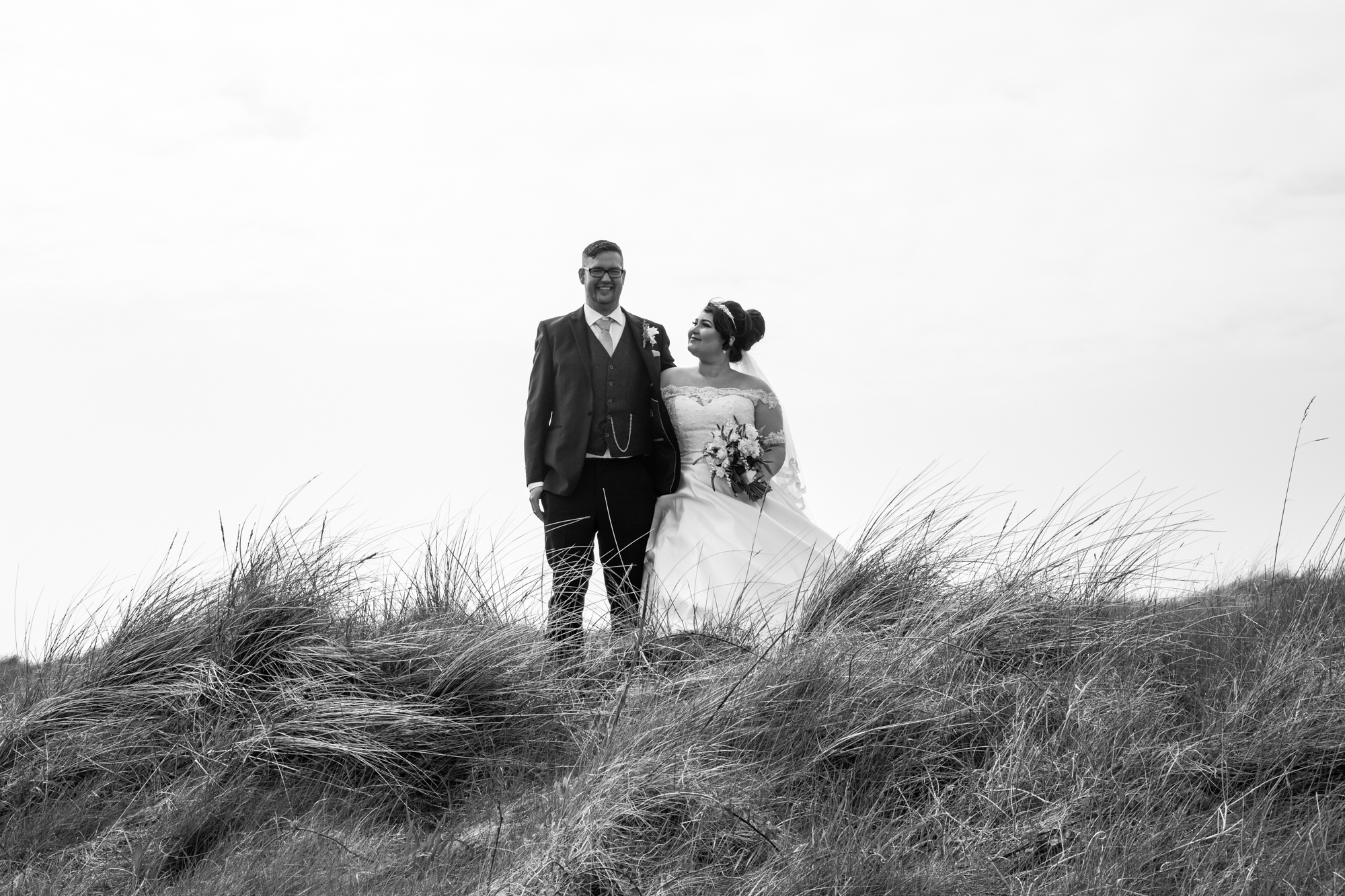 Burry Port Wedding Black and White Bride and Groom Photography. A Beach Wedding Portrait. Photographer covering The Gower, Carmarthenshire, Llanelli, South Wales and Bridgend