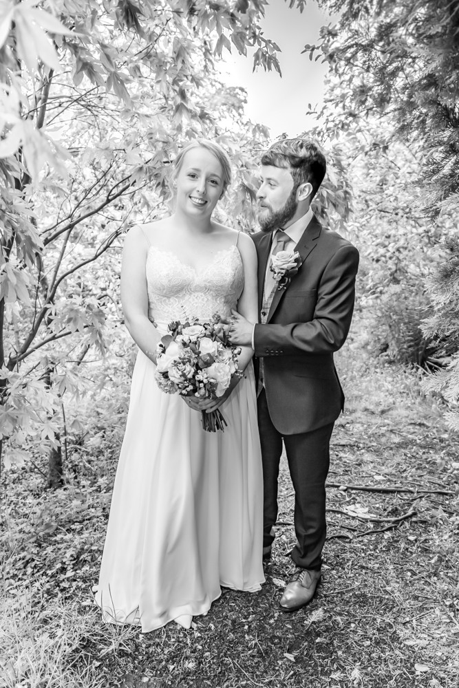black and white documentary wedding photography amongst trees naturally posed