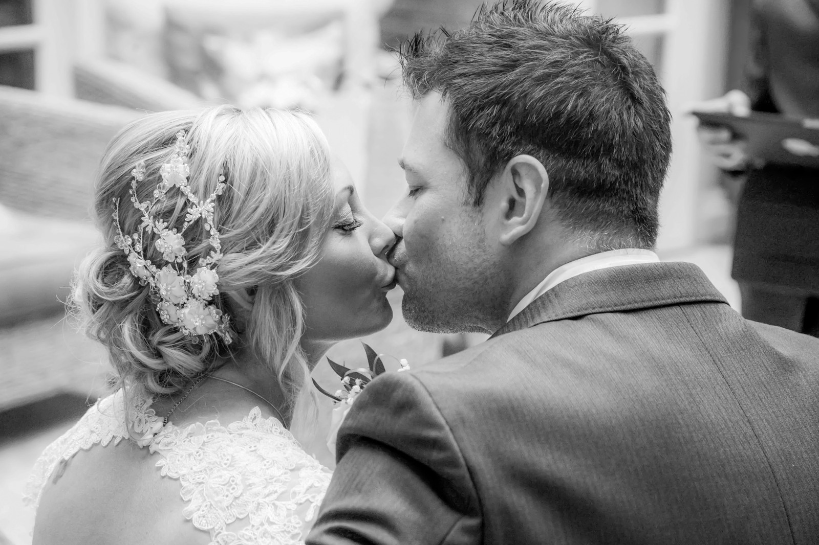 Black and white wedding photographer in swansea the gower carmarthenshire and south wales couples kiss