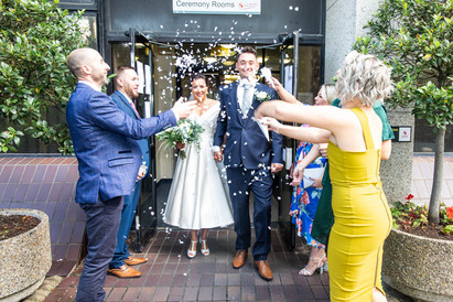 confetti being thrown as couple leave swansea registrars