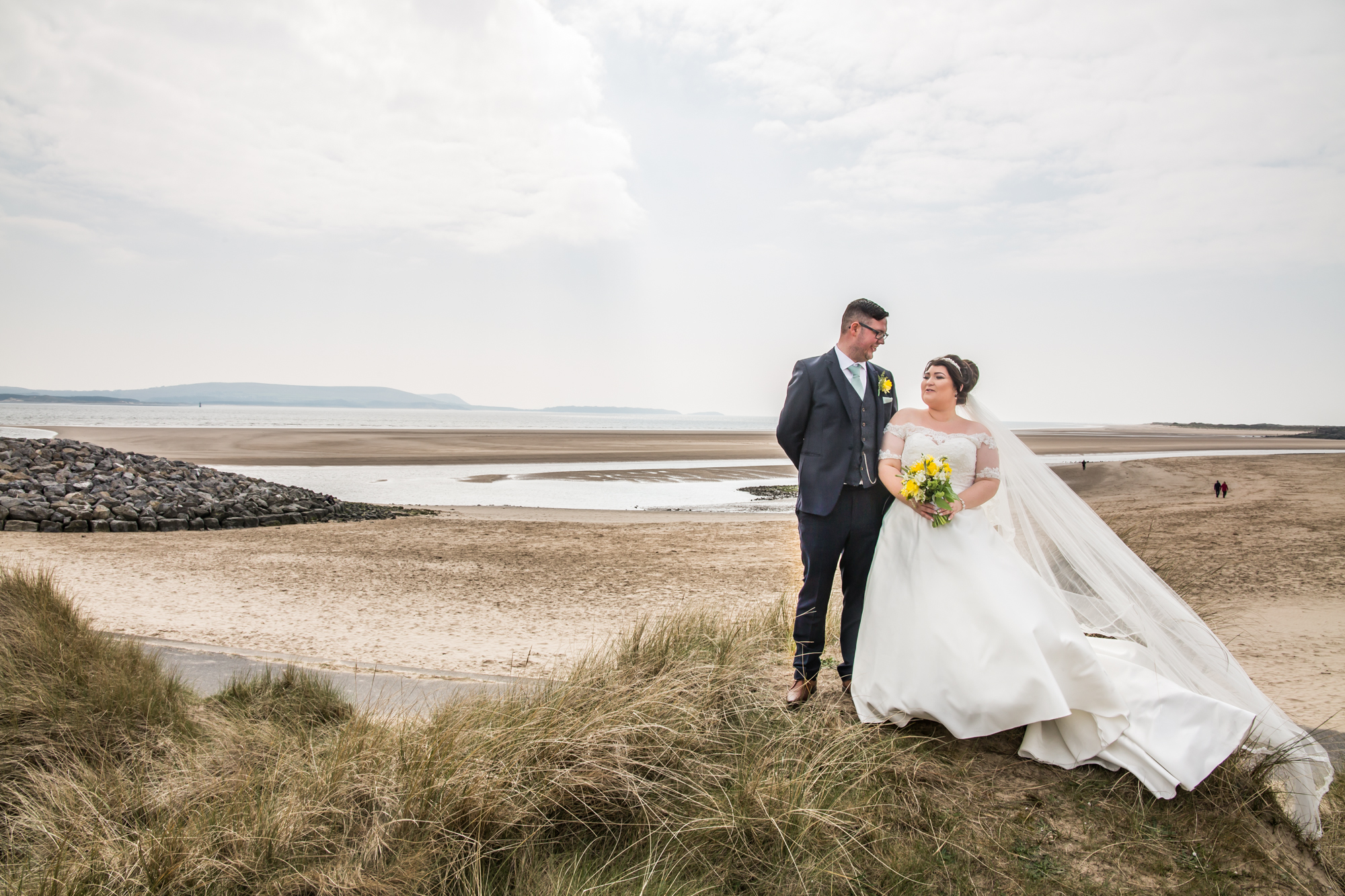 Burry Port  Beach Wedding Photography Bride and Groom dune portrait covering The Gower, Carmarthenshire, Llanelli and South Wales