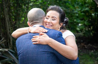 bride embraces wedding guest in swansea bay
