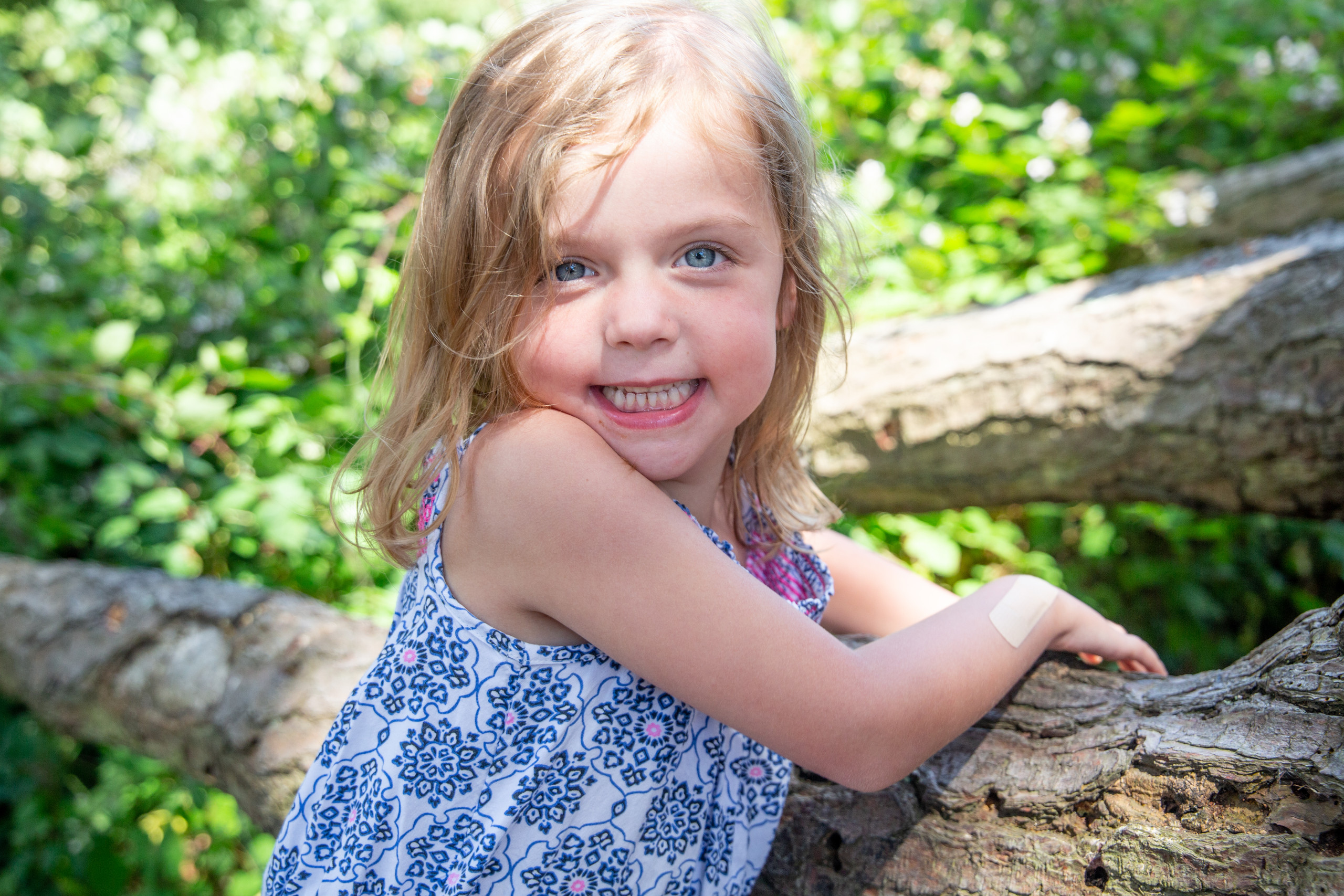 happy moment for a girl as she poses by a tree