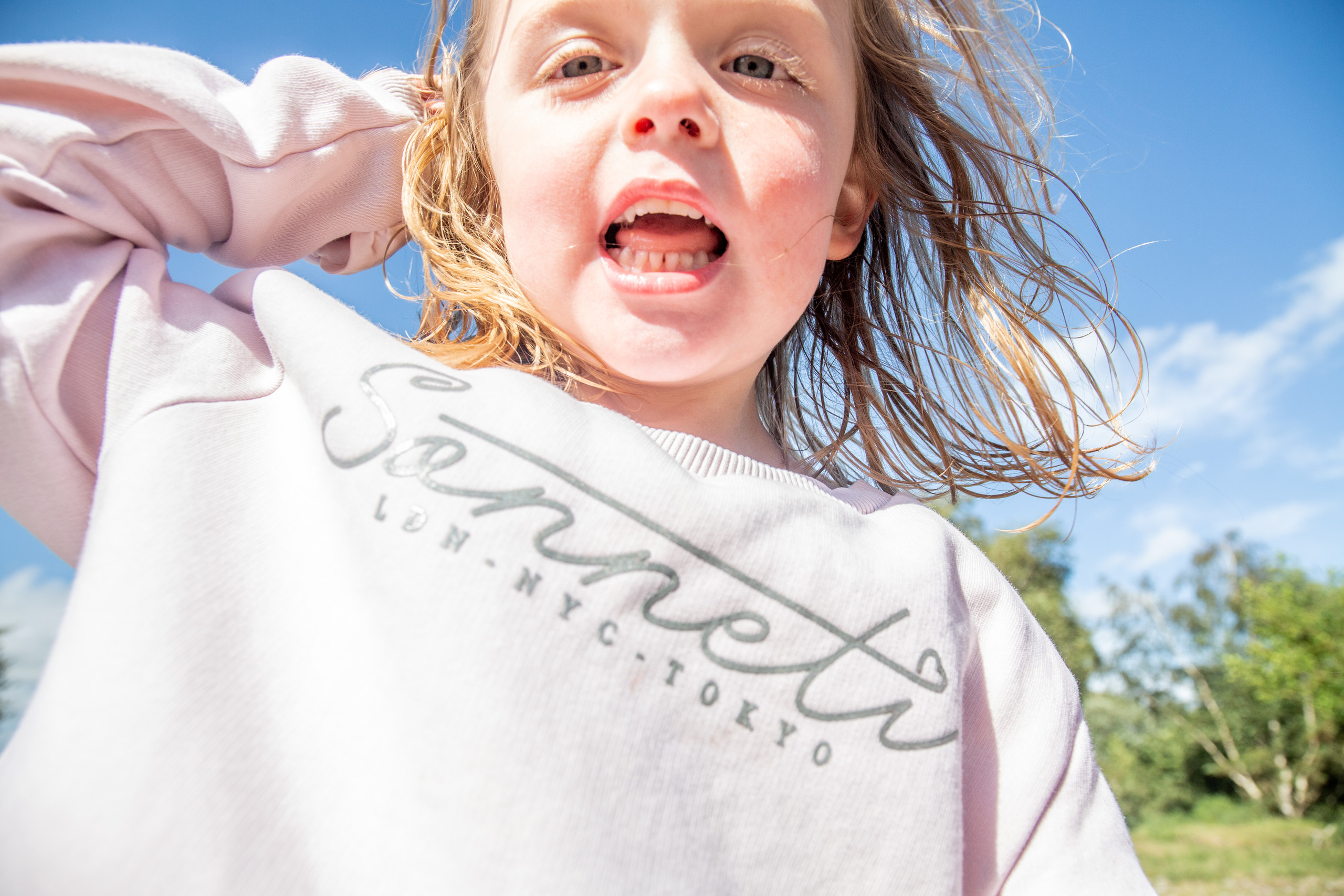 Girl shouts at the photographer in a swansea outdoor location
