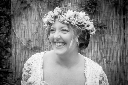 blushing swansea bride smiles in a black and white photograph