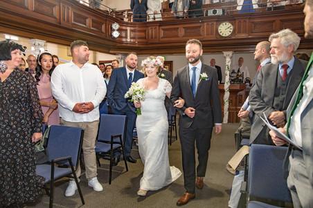 bride walks down swansea and gower church aisle