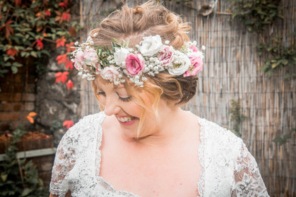 natural bridal floral headdress worn by the bride while posing for wedding photography