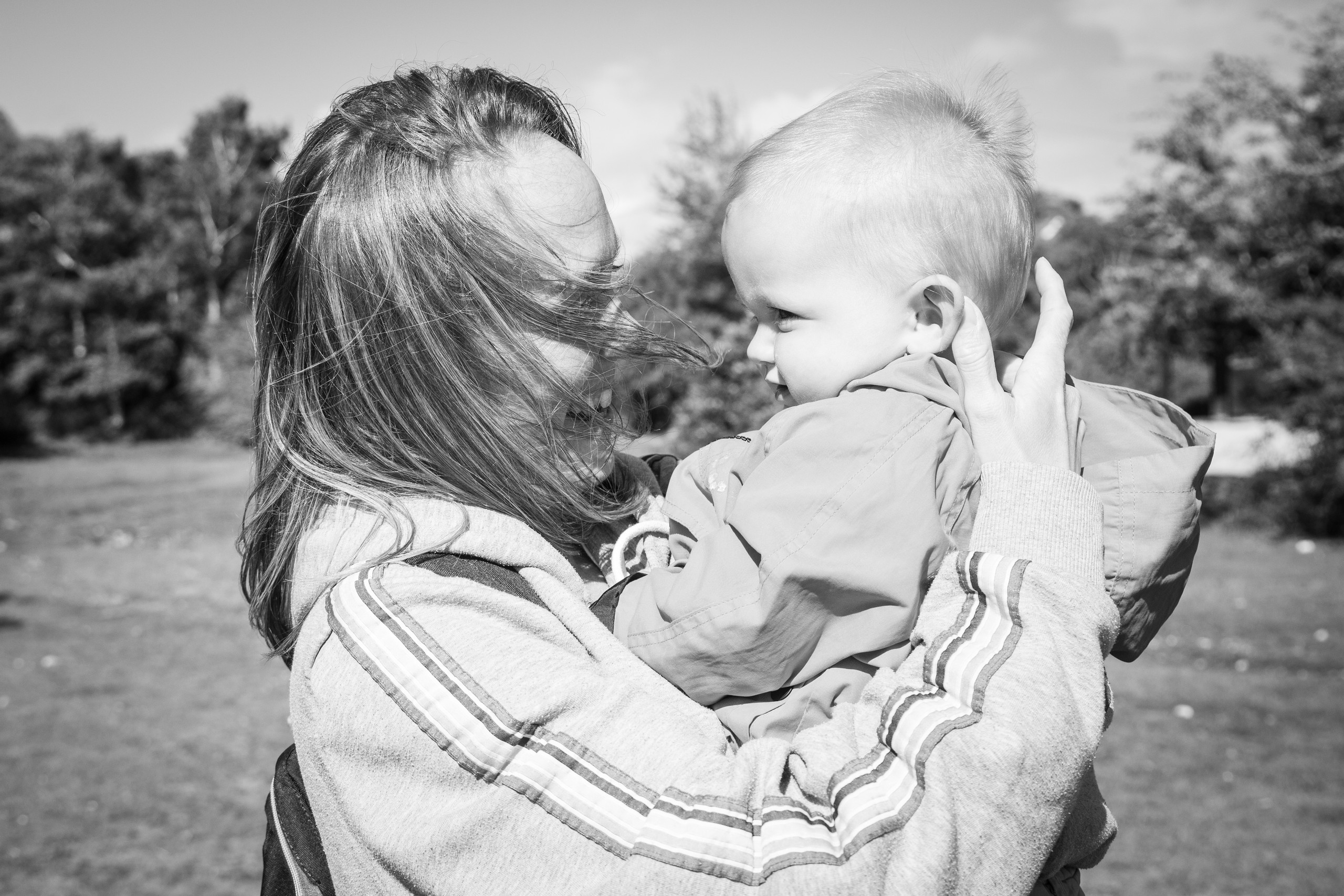 natural lifestyle portraiture shot of mother and son in black and white