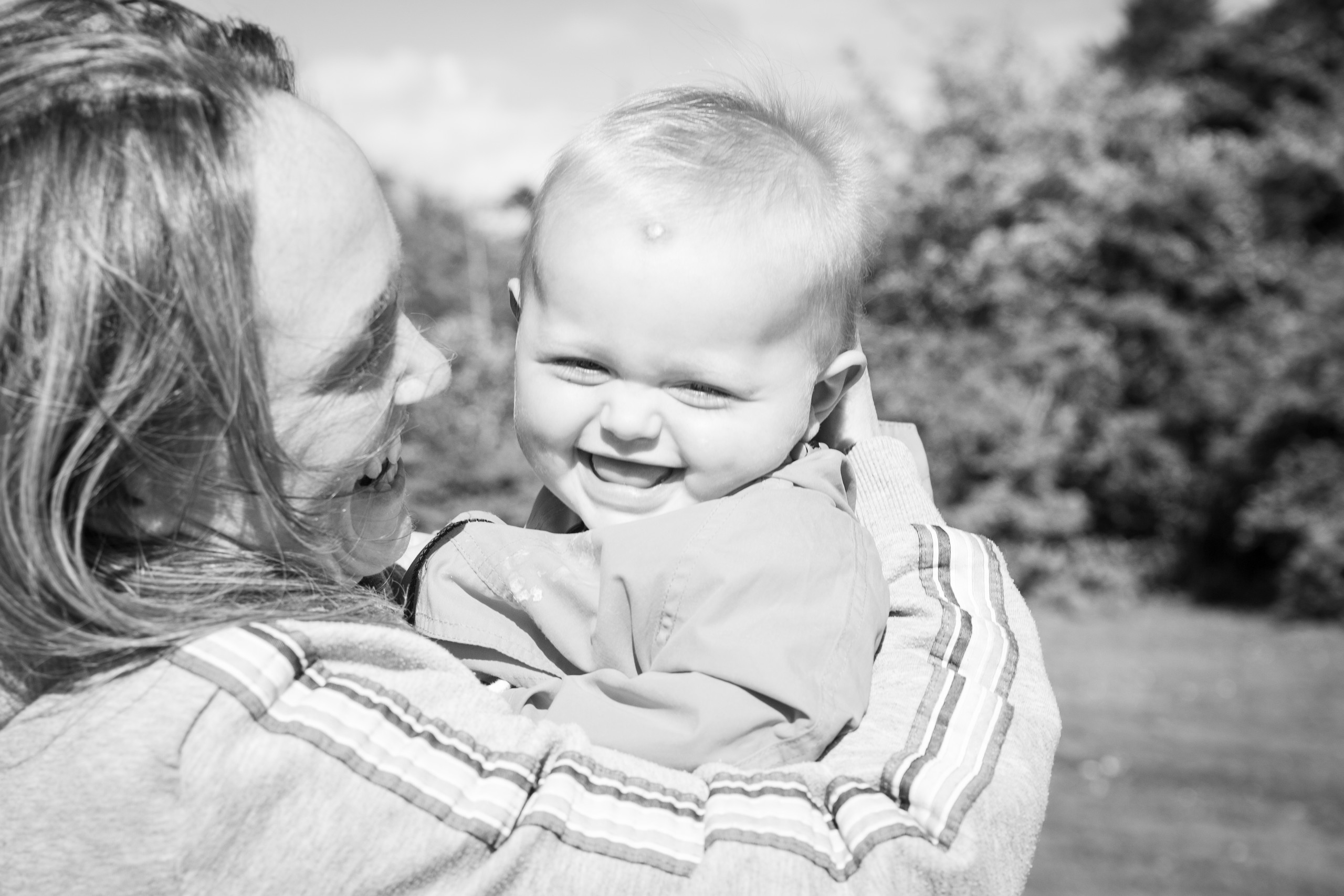 baby chuckles as mum plays with him in a swansea and gower location