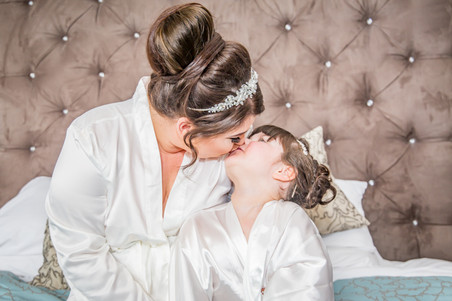 Natural Wedding Photography Photo of Bride and Daughter kissing  in South Wales, Swansea, Carmarthen and The Gower