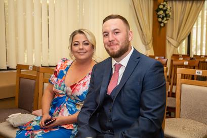wedding guests sit in swansea registrars