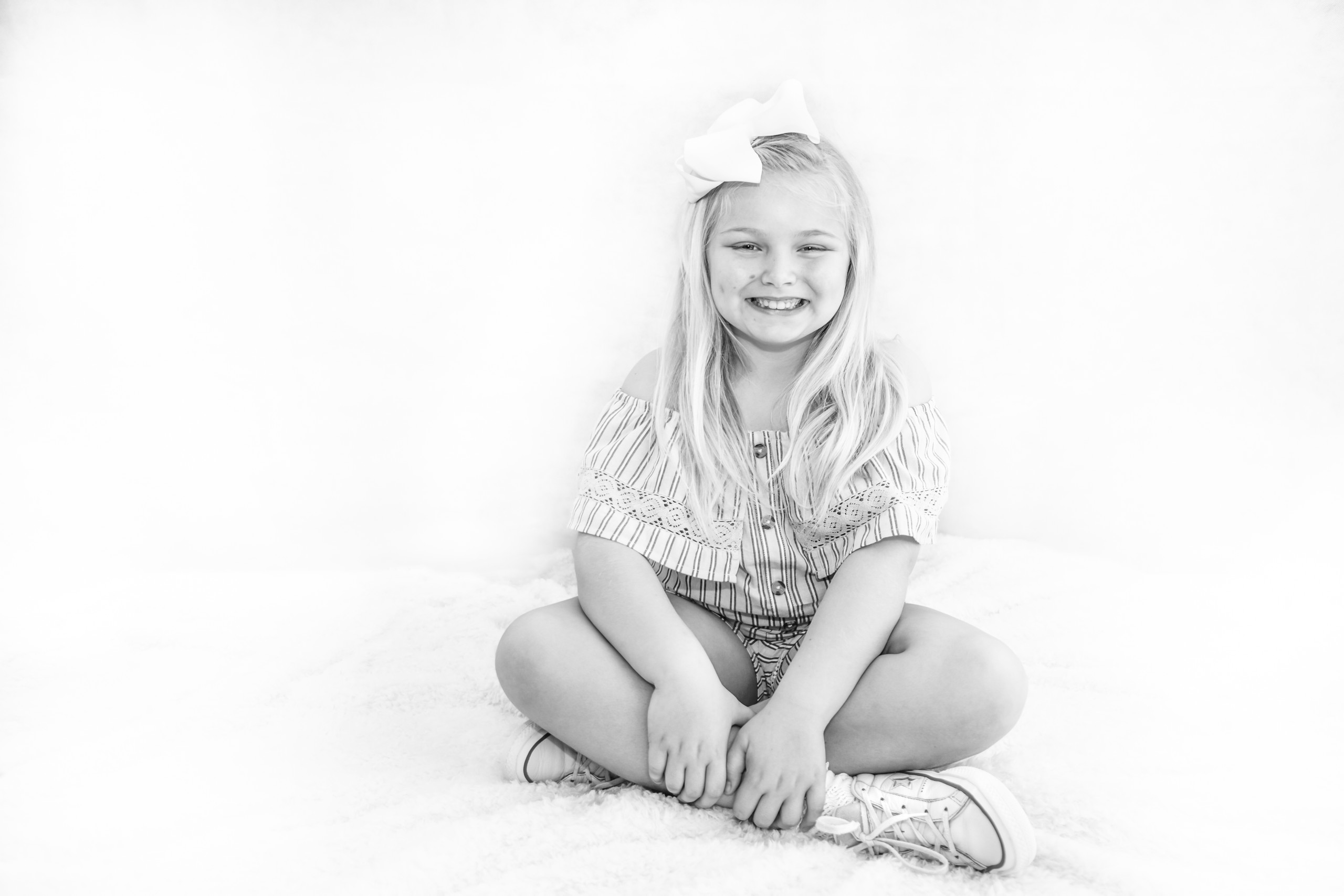 Swansea Family Portrait Black and White Photography of sitting child Photographer also covers the Gower, Carmarthenshire, Llanelli and South Wales for Babies, Children and Pets