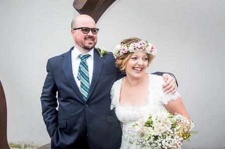 bride and groom laugh on in a swansea wedding venue