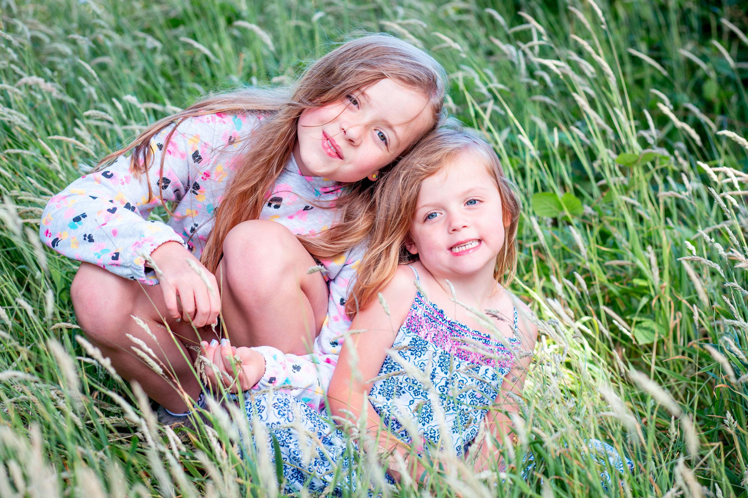 sister photography session in a woodland grass in swansea