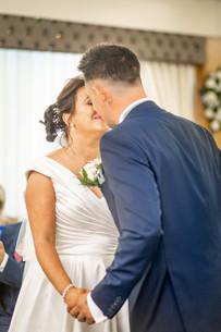 first kiss of the wedding between bride and groom in swansea