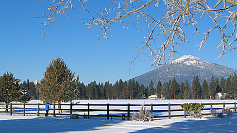 The pasture and Black Butte under a blanket of snow