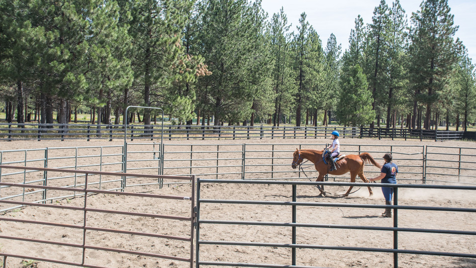 Riding lesson in round pen in east arena