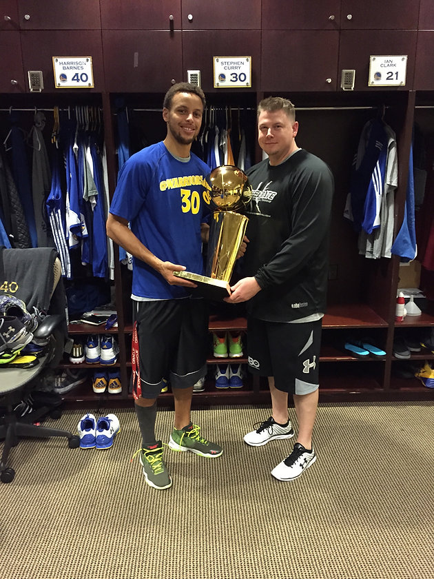 Steph and Brandon with Champ. Trophy.JPG