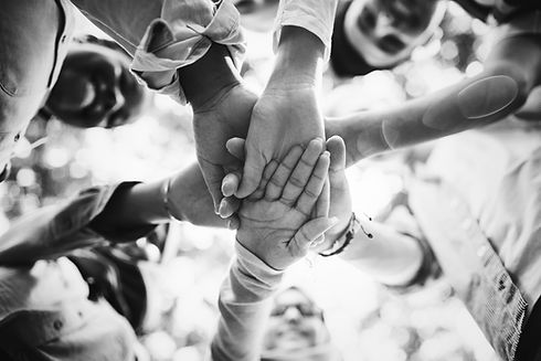 group-young-friends-stacking-hands.jpg