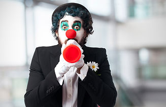 clown-with-a-toy-trumpet.jpg