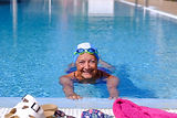 Senior happy woman with swim cap and swi