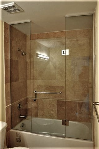 Tub glass enclosure