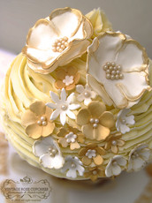 Giant golden anniversary cake