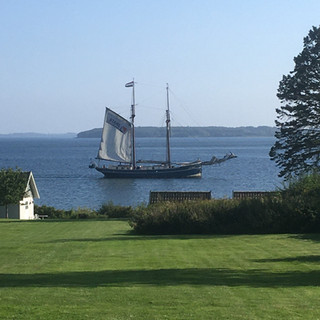 A Ship Passing By the House