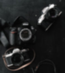 three-black-and-gray-dslr-and-slr-camera