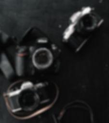 three-black-and-gray-dslr-and-slr-camera