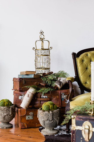 vintage-leather-suitcases-stacked-as-table-display