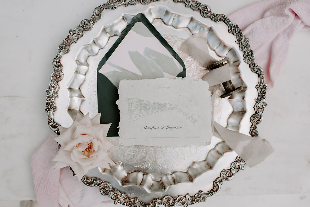 Stationery details styled on vintage silver tray