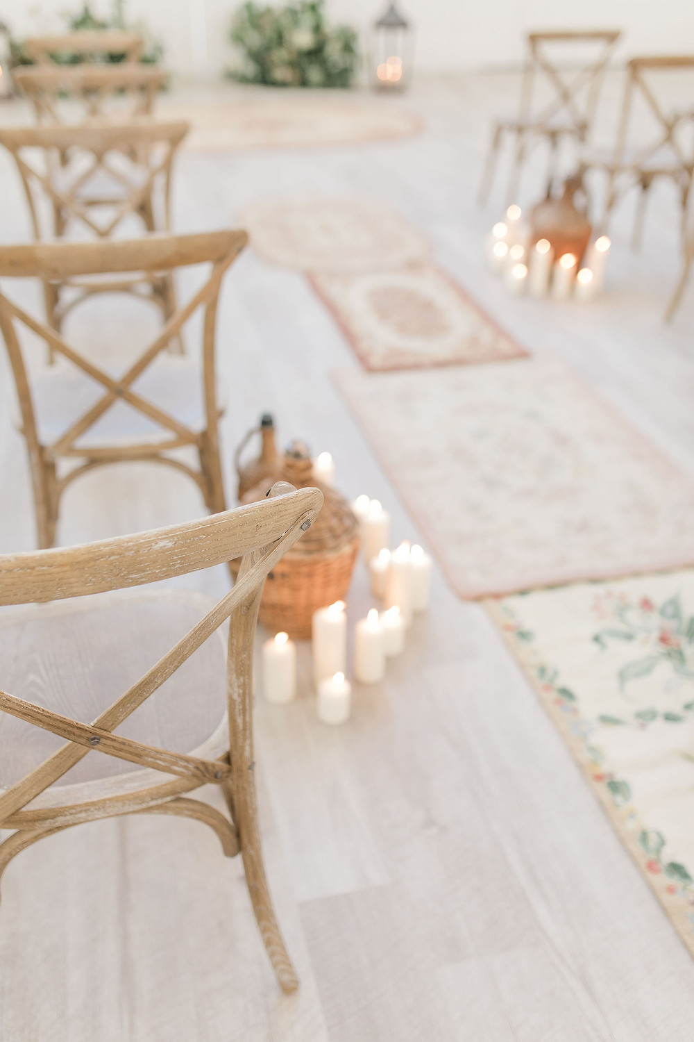 Vintage demijohns and candles are a nod to the vineyard wedding venue