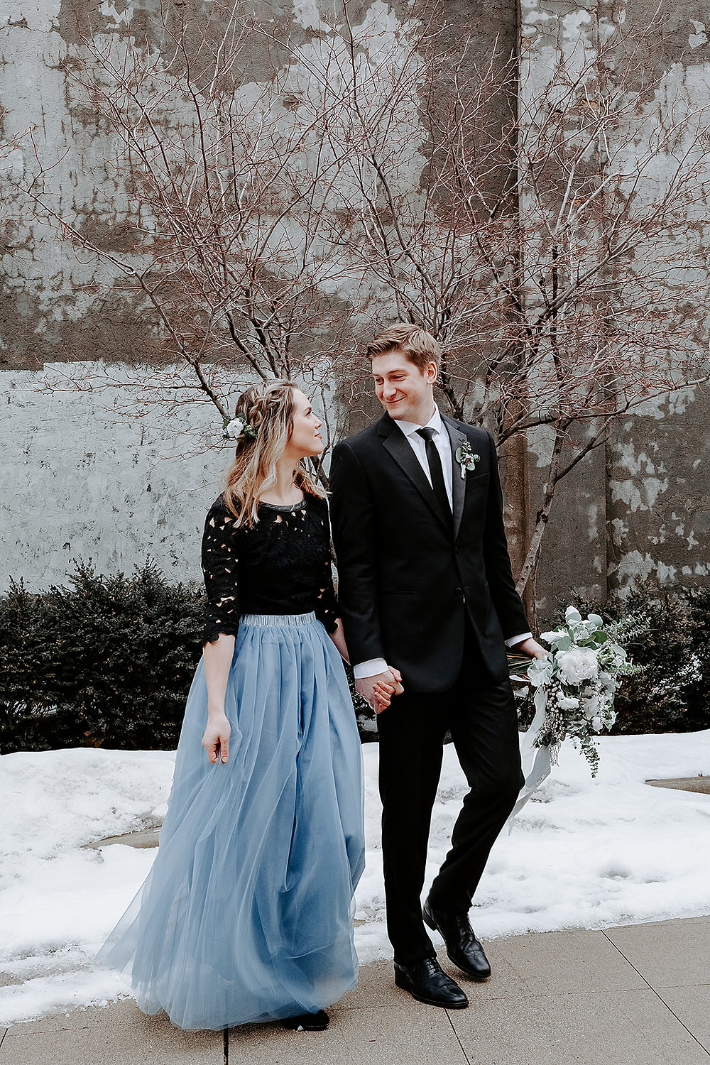 Bride and groom pose for photos following elopement ceremony at urban, Elgin IL venue