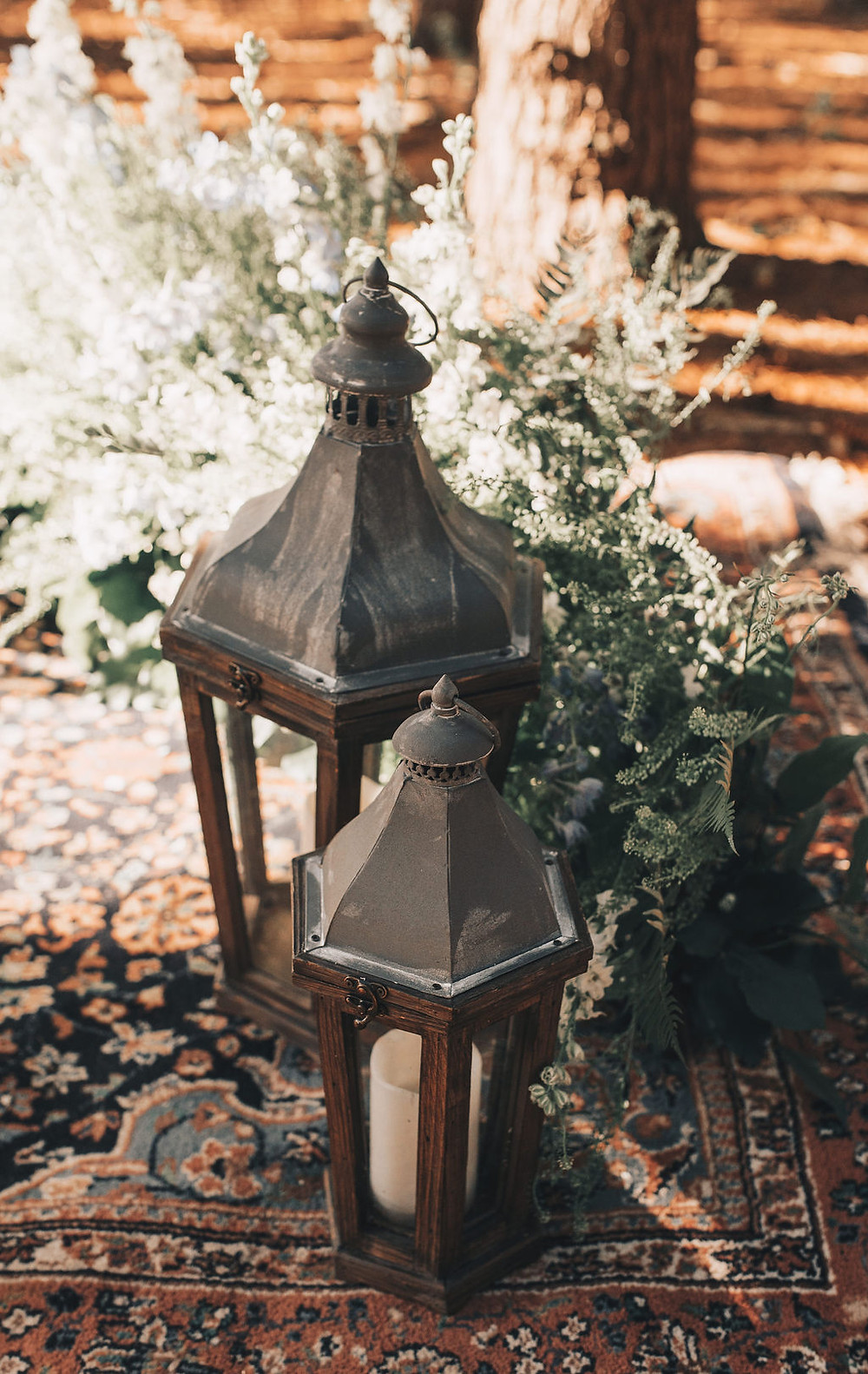 Pottery Barn lanterns create simple lighting for the woodsy elopement wedding site
