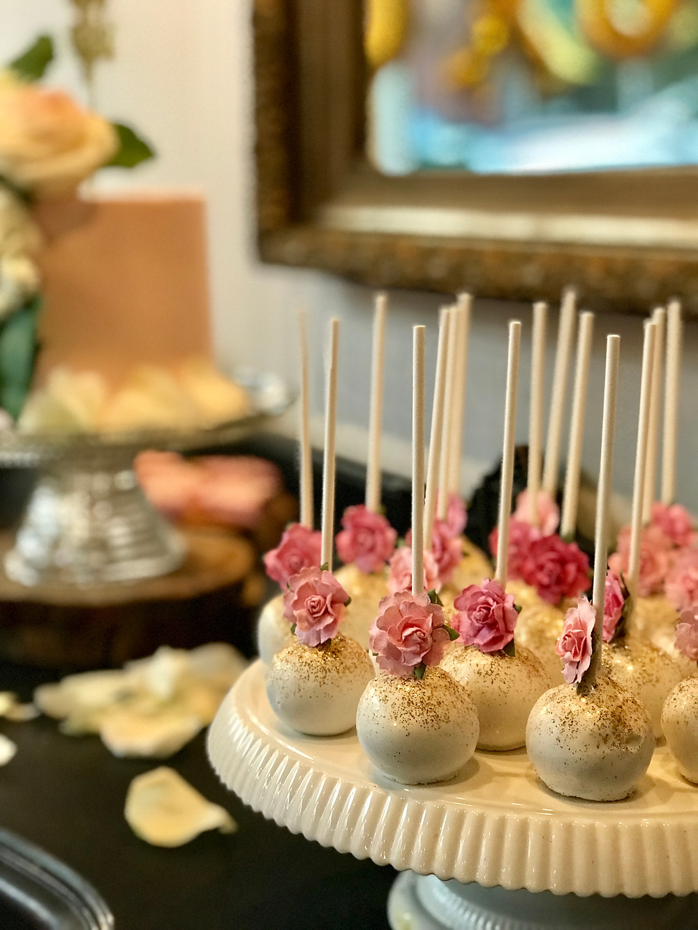 Tasty cake pops added to the deluxe display on the vintage sweets table at The Loft