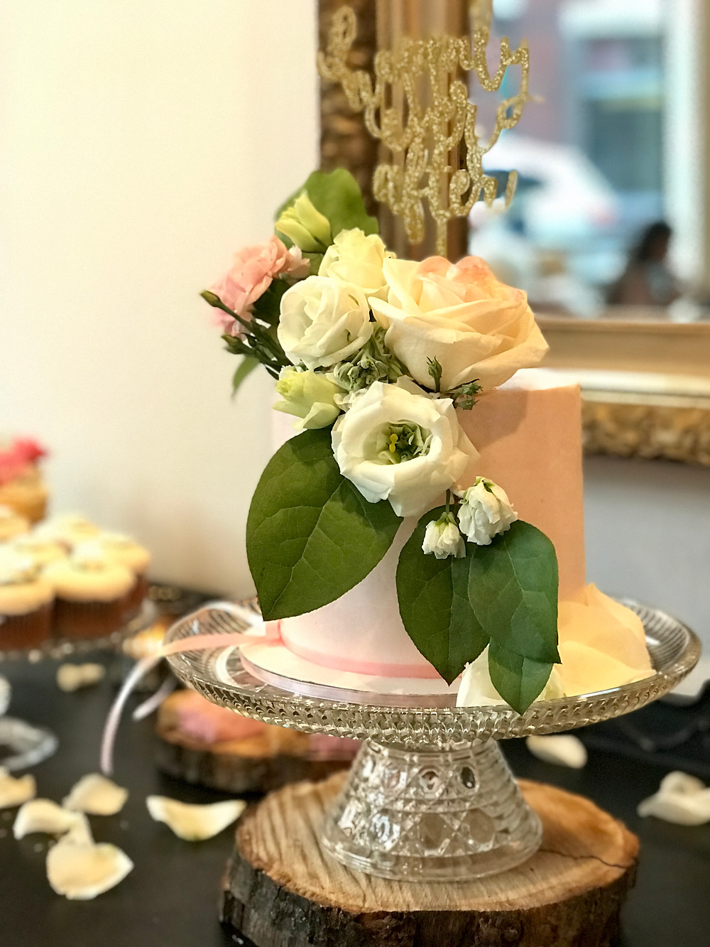 Pink fondant cake with beautiful fresh flowers was the star at the dessert table.
