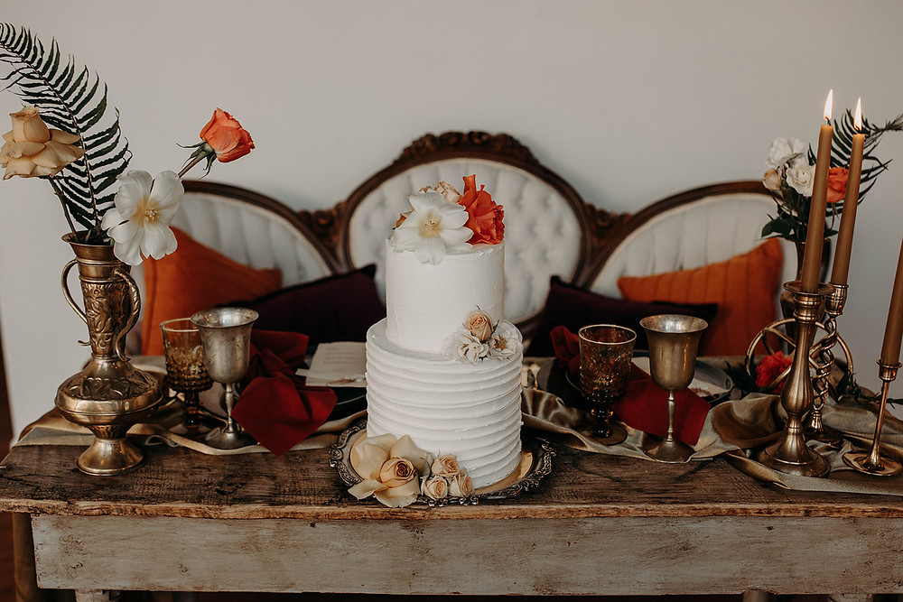 Simple wedding cake styled with florals for the sweetheart table design.