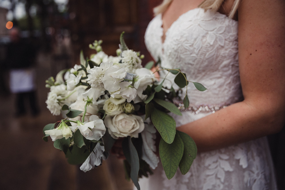 Beautiful, white, bridal bouquet with touches of green were the bride's simple requests