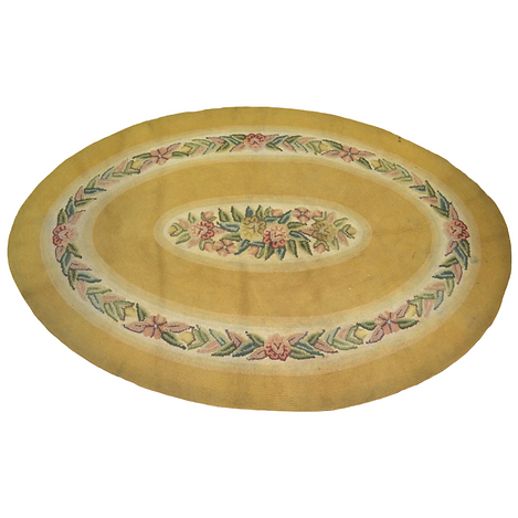 Yellow oval hooked rug with roses